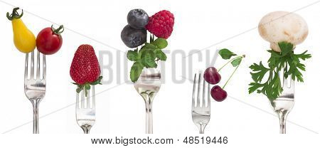 vegetables and fruits on the isolated forks, diet concept