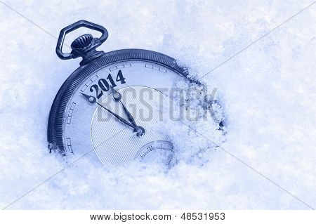 Pocket watch in snow New Year 2014 greeting card
