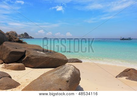 Similan Islands, Andaman Sea, Thailand.  Finest white sand beach adjacent to the great brown cliffs and azure water. Unusual beach