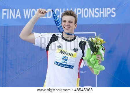 Jul 26 2009; Rome Italy; Paul Biedermann (GER) shows his medal to the crowd after winning the mens 400m freestyle final at the 13th Fina World Aquatics Championships