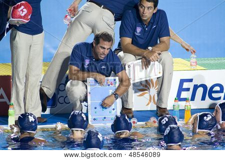 Jul 29 2009; Rome Italy; USA team head coach Adam Krikorian gives instructions during half time in the womens waterpolo semi final match between USA and Greece, USA won the match 8-7
