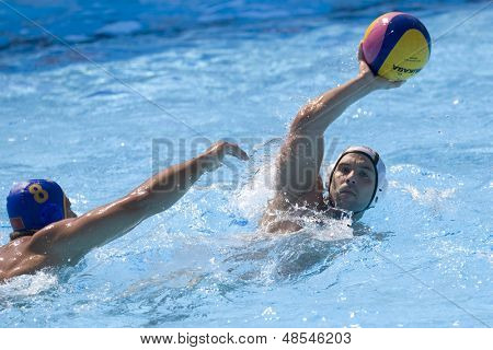 Jul 26 2009; Rome Italy; Germany team player Marko Savic throws a pass while competing in the waterpolo match between Germany and Montenegro at the 13th Fina World Aquatics Championships