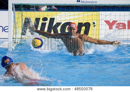 Jul 22 2009; Rome Italy; Genai Kerr USA team player fails to stop a penalty from Nebojsa Milic competing preliminary round waterpolo match in the 13th Fina World Aquatics Championships