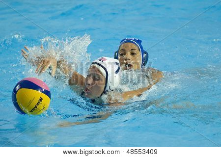 Jul 23 2009; Rome Italy; Kelly Rulon (USA) reaches for the ball while competing in the preliminary round of the waterpolo match between USA and Greece at the 13th Fina World Aquatics Championships