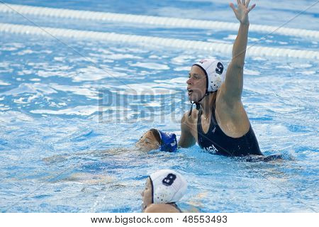 Jul 23 2009; Rome Italy; Elsie Windes (USA) holds down her opponent while during the preliminary round of the waterpolo competition between USA and Greece at the 13th Fina World Aquatics Championships