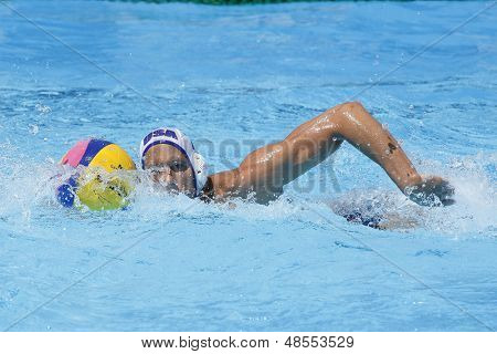 Jul 24 2009; Rome Italy; USA team player Peter Varellas swims with the ball while competing in the preliminary round of the men's waterpolo at the 13th Fina World Aquatics Championships
