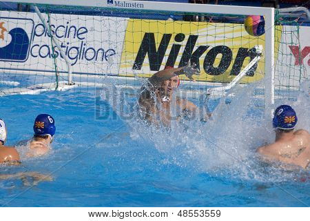 Jul 22 2009; Rome Italy; Dimitar Stojcev Macedonia team player scores a goal competing preliminary round waterpolo match between USA and Macedonia in the 13th Fina World Aquatics Championships