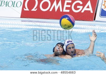 Jul 24 2009; Rome Italy; USA team player Brian Alexander defends against Nicolae Diaconu (ROU) competing in the preliminary round of the men's waterpolo at the 13th Fina World Aquatics Championships