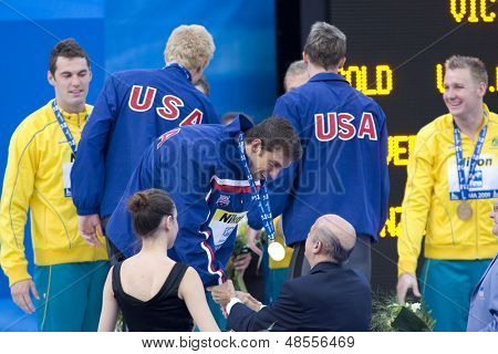 Jul 02 2009; Rome Italy;  Michael Phelps receives his medal  for  the mens 4 x 100m medley final  at the 13th Fina World Aquatics Championships held in the The Foro Italico Swimming Complex.