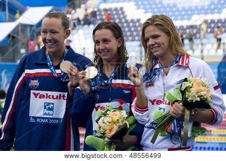 Jul 28 2009; Rome Italy; Kasey Carlson (USA) bronze medal winner, left Rebecca Soni (USA) gold medal winner, centre and Yuliya Efimova (RUS) silver medal winner, right in the womens 100m breaststroke