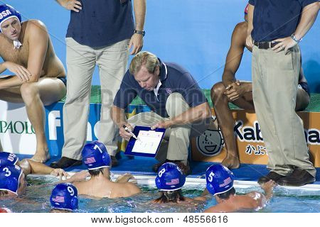 Jul 30 2009; Rome Italy; USA team head coach Terry Schroeder gives instructions during a time out in the semi final match between USA and Spain at the 13th Fina World Aquatics Championships