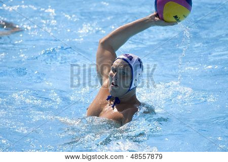 Jul 28 2009; Rome Italy; USA team player Jesse Smith takes a shot at the goal while competing in the waterpolo quarterfinal match between USA and Germany at the 13th Fina World Aquatics Championships