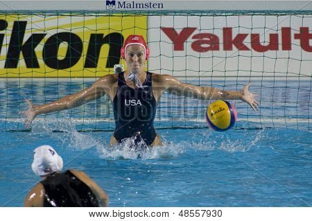 Jul 31 2009; Rome Italy; USA team goalkeeper Elizabeth Armstrong faces Canadian team player Emily Csikos during a penalty during the final of the womens waterpolo tournament, USA won the match 7-6,