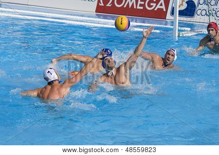 Jul 22 2009; Rome Italy;  Ronald Beaubien USA team player takes a shot at the goal competing preliminary round waterpolo match between USA and Macedonia in the 13th Fina World Aquatics Championships