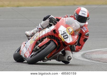 26 Sept 2009; Silverstone England: Rider number 10 Michael Rutter GBR riding for Bathams Ducati  during the free practice session of the British Superbike Championship: