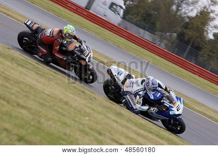 26 Sept 2009; Silverstone England: Rider number 2 Leon Camier (GBR) riding for Airwaves Yamaha  and Rider number 45 Glen Richards AUS riding for HM Plant Honda at the British Superbike Championship:
