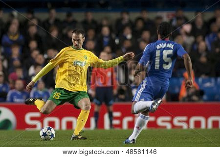 LONDON ENGLAND 23-11-2010. MSK Zilina's defender Jozef Pia�?�?�?�ek and Chelsea's midfielder Florent Malouda in action during the UEFA Champions League group stage match between Chelsea FC and MSK Zilina