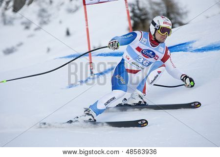 VAL GARDENA, ITALY 18 December 2009. Patrick Kueng SUI)  competing in the Audi FIS Alpine Skiing World Cup Super-G race on the Saslong course in the Dolomite mountain range.