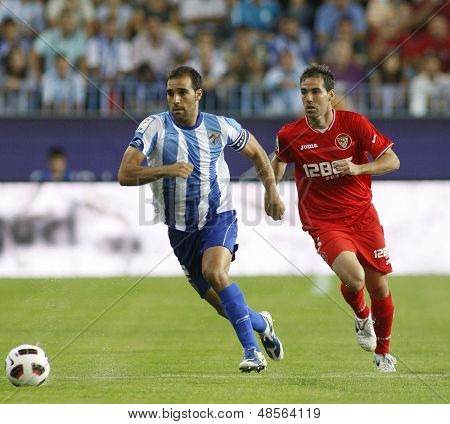 MALAGA, SPAIN. 19/09/2010. Jesus G�?�?�?�¡mez the Malaga defender and Fernando Navarro a Sevilla defender in action during the La Liga match between CF Malaga and Sevilla, played in the La Rosaleda Stadium