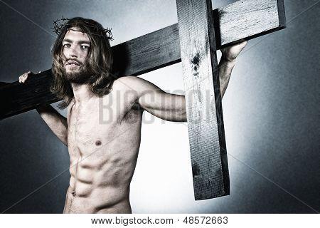 Jesus Christ of Nazareth carrying the cross.