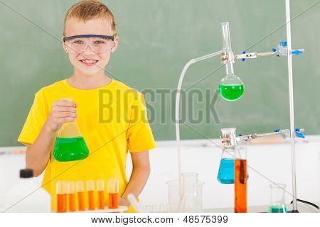 male elementary school student in the lab holding a flask