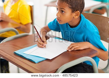 adorable african american primary school student studying Chinese in classroom