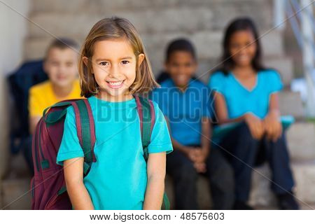 pretty preschool girl with schoolmates on background