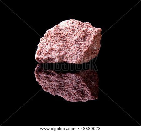 Uncut rock piece of sandstone a sedimentary rock composed of sand-sized minerals