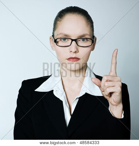 studio shot portrait of one caucasian young  teacher nanny business woman pointing up finger