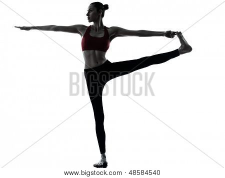 one caucasian woman exercising yoga  Revolved Hand to Big Toe Pose in silhouette studio isolated on white background