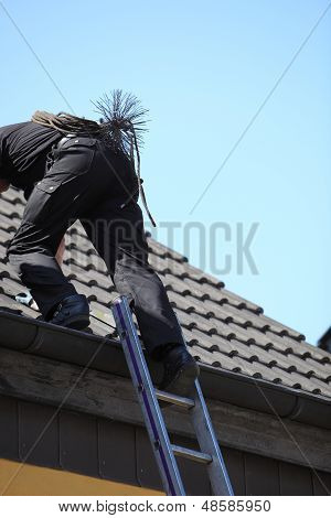 Chimney Sweep Climbing Onto The Roof Of A House