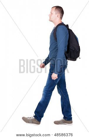 back view walking man with backpack.  brunette guy in motion. backside view person.  Rear view people collection. Isolated over white background. young man goes to side rolling travel bag on wheels
