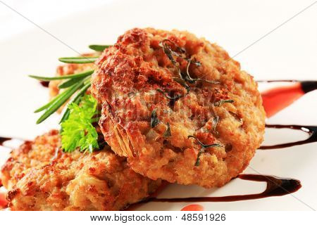 three fried vegetarian burgers with herbs and sauce