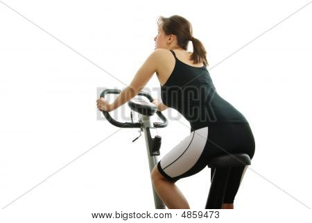 Isolated Young Woman Riding On A Bicycle