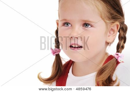 Portrait Of Cute Little Girl With Braids