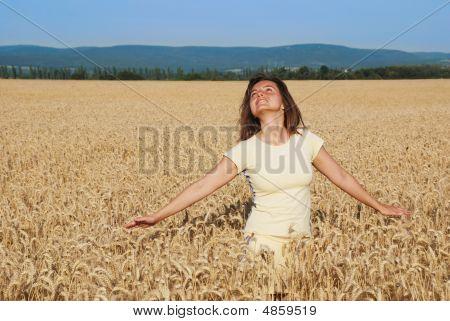 Young Woman Enjoying In Grain Field