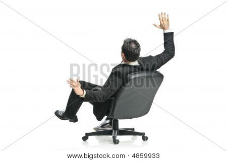 A Young Businessman In A Chair