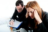 stock photo of down jacket  - Two business colleagues looking very stressed in work - JPG