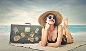 stock photo of sunbathers  - beautiful woman sunbathing at the beach - JPG