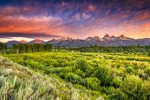 stock photo of blacktail  - Colorful sunrise at Blacktail Ponds Overlook in the Tetons - JPG
