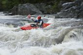 stock photo of canoe boat man  - Side view of a man kayaking in rough river - JPG