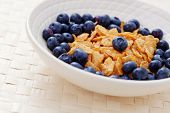bowl of cereals with blueberry fruits - diet and breakfast