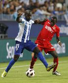 MALAGA, SPAIN. 19/09/2010. Quincy Owusu-Abeyie the Malaga forward shields the ball from Didier Zokor