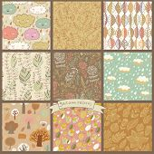 Set of eight autumn seamless patterns with rain clouds, leafs, flowers, trees. Cute vector backgroun