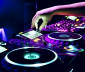 stock photo of  dancer  - Dj mixes the track in the nightclub at a party - JPG
