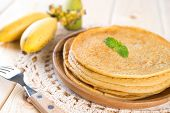 stock photo of crepes  - Banana pancakes or crepe on dining table - JPG