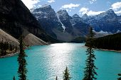 stock photo of tourist-spot  - Moraine Lake with beautiful turquoise blue watera famous tourist spot in Canadian Rockies  - JPG