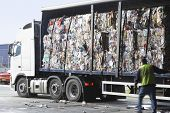 stock photo of lorries  - Stacks of recycled paper in lorry at recycling plant - JPG