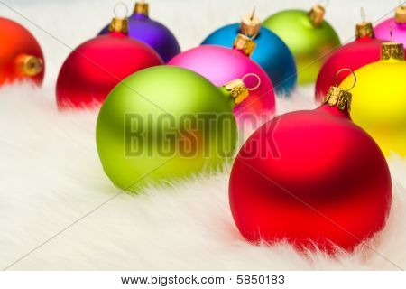Many Christmas Baubles On White Fur