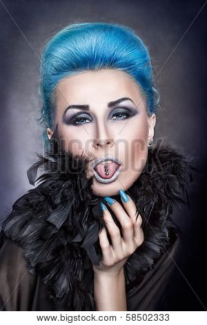 Girl With Blue Hair Shows A Pierced Tongue.